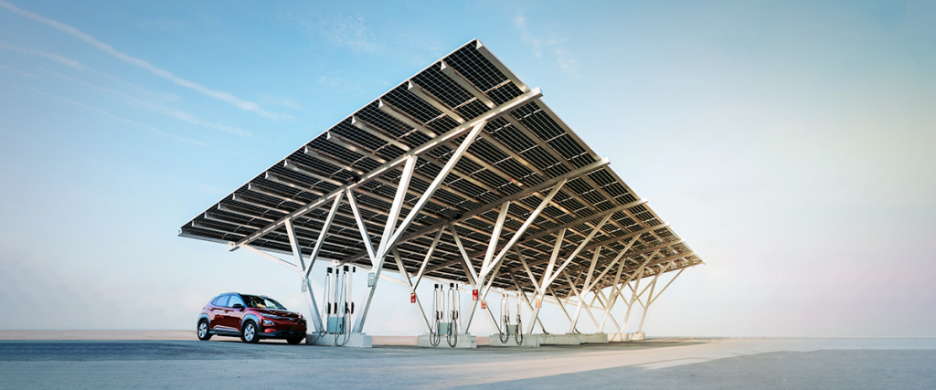 Solar carport showing vehicle charging under solar cell canopy