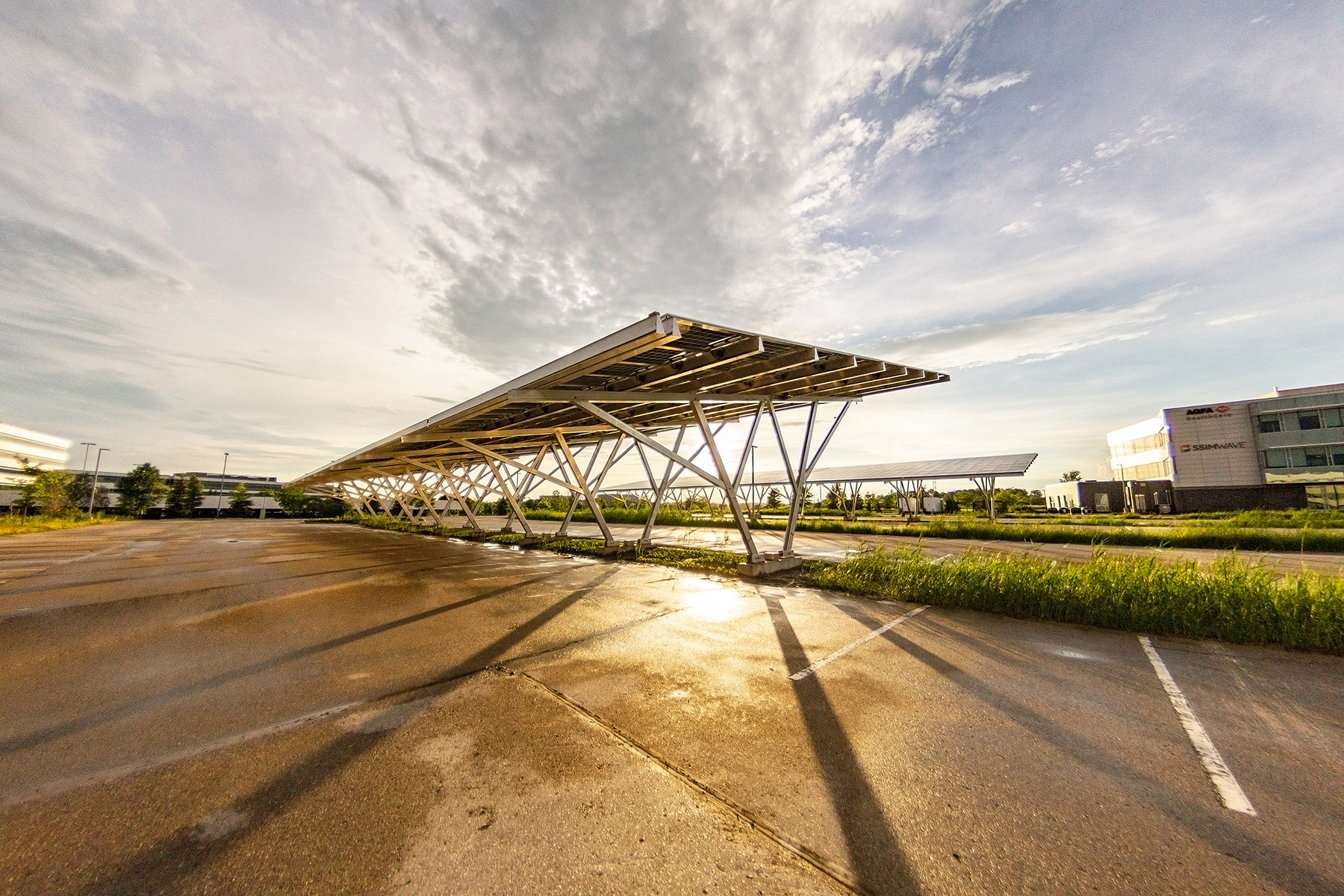 Solar carport canopy, photographed at sunset with dramatic shadows