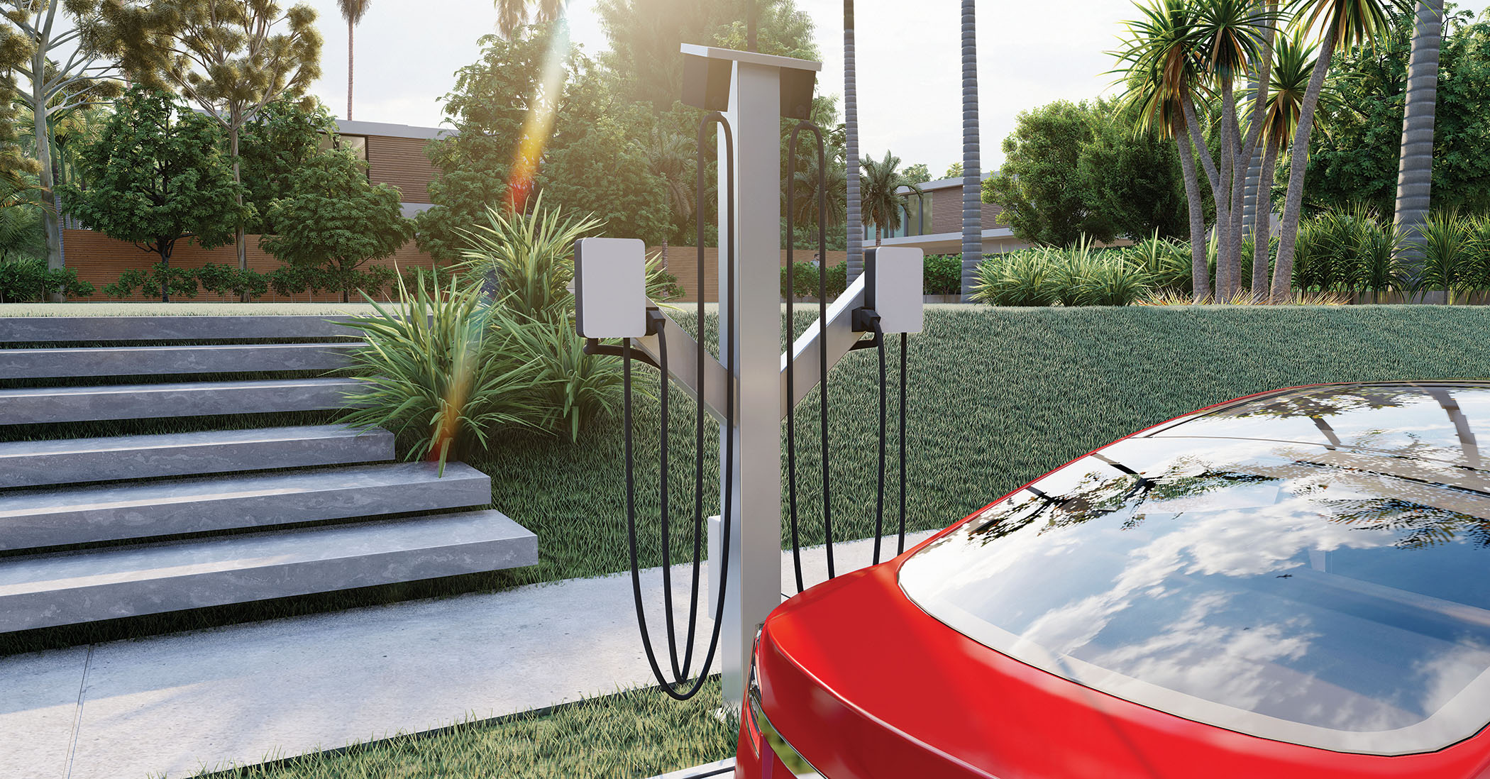 Image of a red electric vehicle parked by a power pedestal charging station